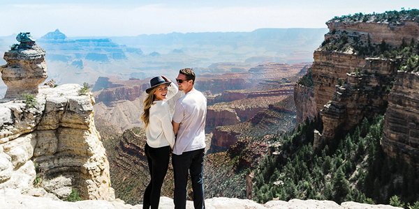A couple poses at the Grand Canyon National Park. Flight departing our Boulder City, NV terminal